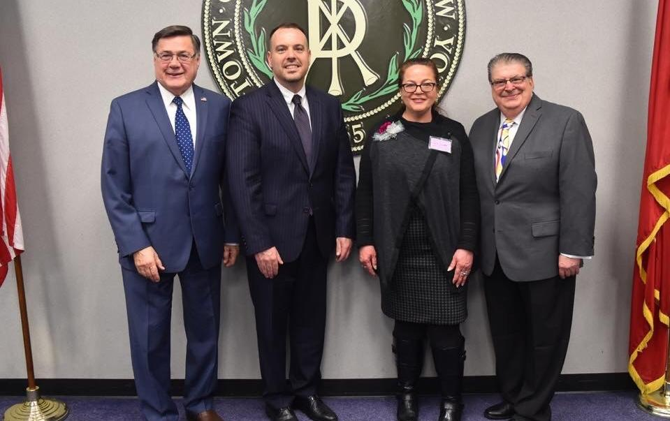 With Cathy Cutler, recipient of the 2019 Town of Brookhaven (TOB) Women in Science Award are, from left, Edward Romaine, TOB Supervisor; Dan Panico, Councilman (District 6); and Louis Marcoccia, TOB Receiver of Taxes. Cutler received the award for her scientific accomplishments in the field of radioisotopes. She was honored at a ceremony held at Brookhaven Town Hall on March 21.